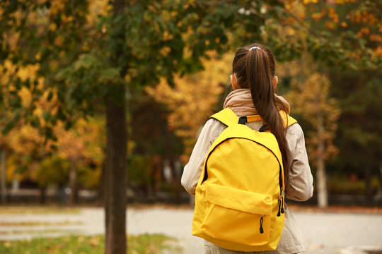Cute girl with backpack going to school