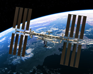 Fotobehang - Flight Of International Space Station On The Background Of Earth