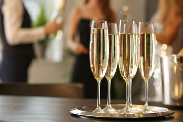 Glasses of champagne on table at party