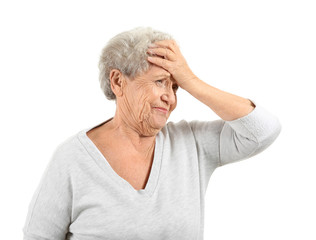 Portrait of elderly woman after making mistake on white background