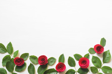 Decorative roses on a white wooden background, copy space. Romantic background by St. Valentine's Day