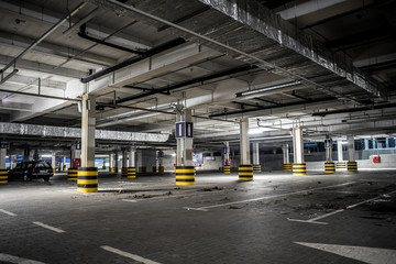 Underground illuminated parking with no people and stripped elements