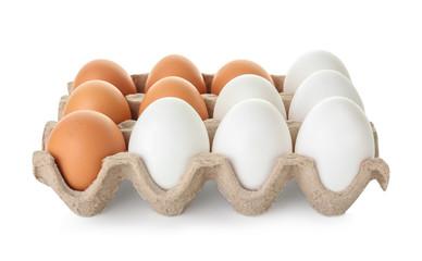 Raw chicken eggs on white background