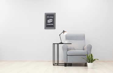 Interior of light room with cozy armchair