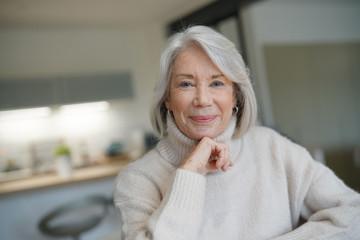 Senior woman looking happy at home