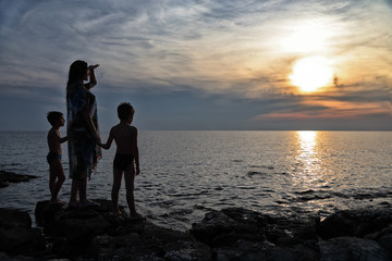 Family Vacation - Mother And Her Sons Enjoying Beautiful Sunset On Beach