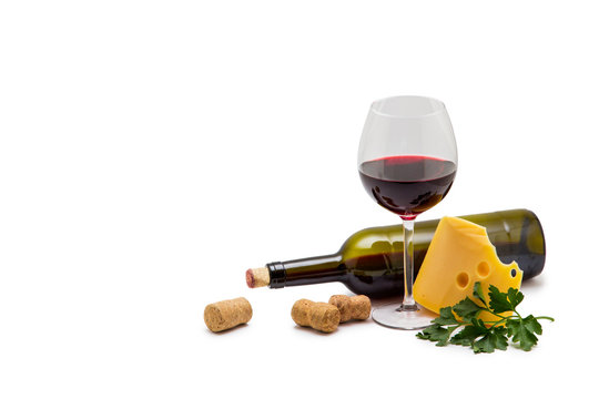 Bottle of wine cheese and grapes
