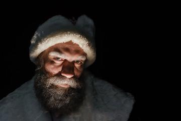 Portrait of a brutal mature Santa Claus. Scary Santa Claus