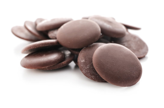 Delicious dark chocolate chips on white background