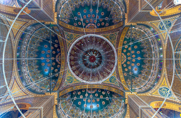 Ceiling of the great Mosque of Muhammad Ali Pasha (Alabaster Mosque) decorated with golden and blue floral patterns, situated in the Citadel of Cairo in Egypt