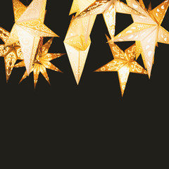 star-shaped paper lantern against night sky - star lampions on black background with copy space