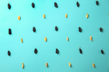 Raisins on color background