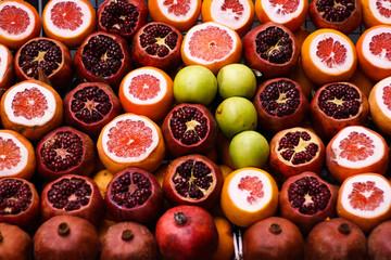 Many ripe juicy fruits - grapefruits, apples, pomegranates