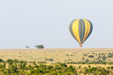 Tourists flying air balloon over the savannah in Masai Mara, Kenya
