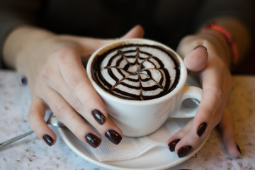 a cup of coffee, cappuccino, latte in beautiful female hands. coffee mood. Cheerful morning in a cafe. wallpaper