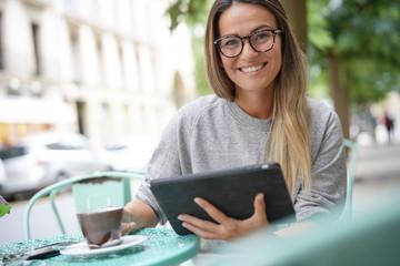 Woman outside a coffee shop