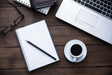 notebook with notepad and coffee