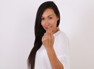 Smiling asian woman gesturing you come here, calling you isolated on white background