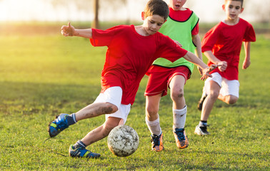 Young children players on the football match