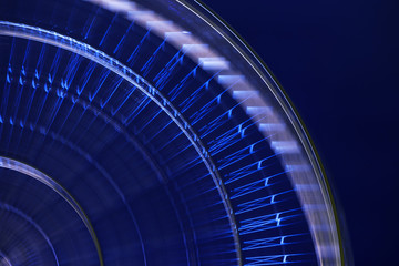 abstract image of a ferris wheel at night in a long shutter speed