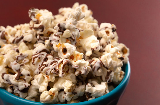 Pile of White and Milk Chocolate Drizzled Sweet Popcorn