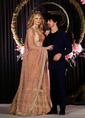 Actor Sophie Turner and singer Joe Jonas pose during a photo opportunity at the wedding reception of Bollywood actor Priyanka Chopra and singer Nick Jonas, in New Delhi