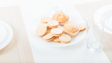 biscuits and cupcakes on plate. food snacks and pastry.