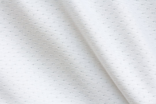 texture of white breathable fabric with large folds, detail of sportswear