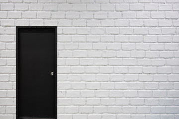 white brick wall background with black door