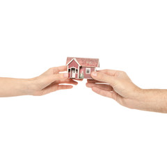 Small house in two hands male female family on white background isolation