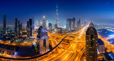 Dubai skyline at night, panoramic aerial top view to downtown city center landmarks. Famous viewpoint, United Arab Emirates