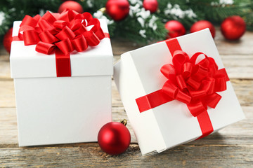 White gift boxes with bauble on wooden table