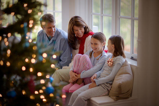 Happy family sitting together on Christmas Day.