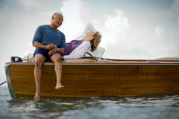 Happy mid-adult couple on a boat together on the ocean.