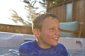 Boy sitting in swimming pool