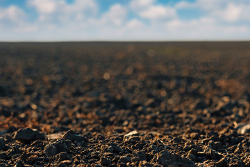 Close up of arable land soil recently ploughed