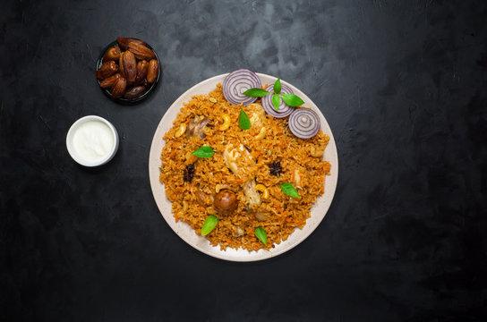 Chicken Makbous Al-Thahera, traditional food in Arabian region. Middle eastern food.