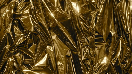 Golden metal foil, wrinkled and shiny. Close-up, abstract image background
