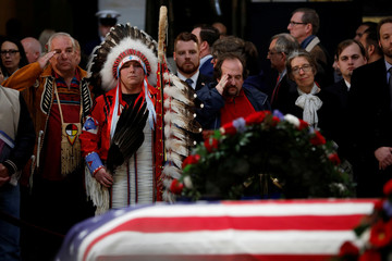Mourners pay their respects at the casket of former U.S. President George H.W. Bush as it lies in state inside the U.S. Capitol Rotunda on Capitol Hill in Washington