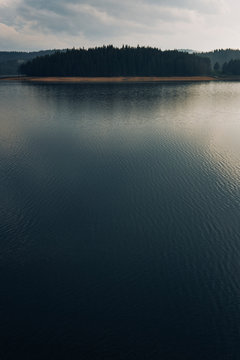 Calm lake surface in light