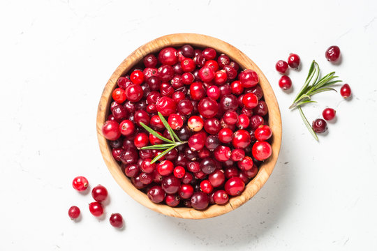 Cranberry in the bowl on white background.