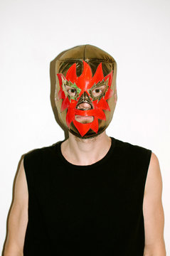 Young man in wrestler mask