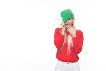 f9eeca6f5a1cad Fashion blond woman wearing bright knitted green hat and red sweater having  fun over isolated white