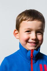 Happy Kid with Sport Sweater, Studio Portrait on White Backgroun