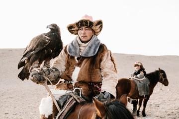 Mongolian Eagle Hunting. Portraits of hunters, falcons and horses. Wild face, unique ethnic costume, ethnic Kazakh, historical.