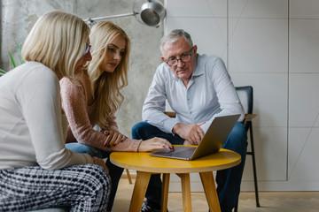Grandparents Looking at Laptop