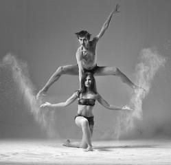 ballet pair of dancers duet jumping with flour.