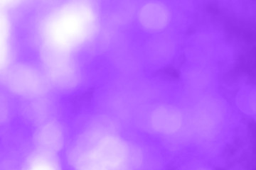 Abstract blur background has bokeh and proton purple color. Horizontal background for design. Selective focus.