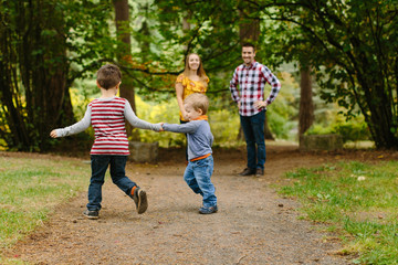 Kids Running in Park with Parents Watching
