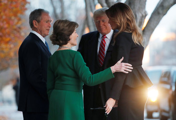 President Trump and first lady Melania Trump arrive to visit former President George W. Bush and Laura Bush at Blair House in Washington